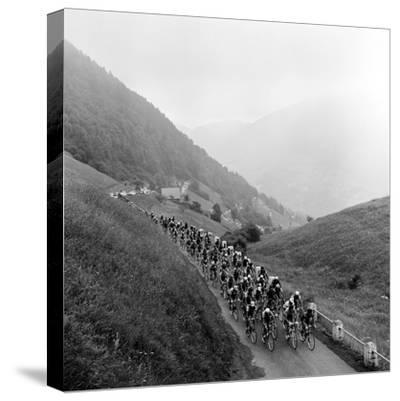 Contestants in the Grueling Tour De France are Seen on Their Way to the Mente Pass--Stretched Canvas Print
