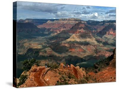 Tourists Hike Along the South Rim of the Grand Canyon--Stretched Canvas Print