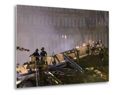 Two New York Firefighters View the Smoldering Rubble--Metal Print