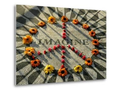 A Makeshift Peace Sign of Flowers Lies on Top John Lennon's Strawberry Fields Memorial--Metal Print