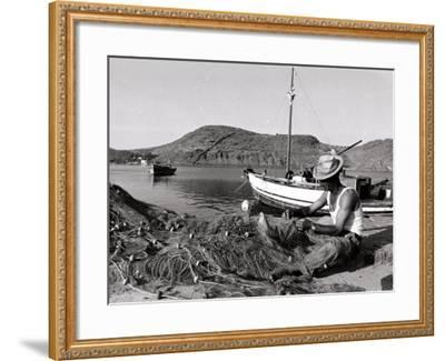 Fisherman Tends to His Nets in Greece--Framed Photographic Print