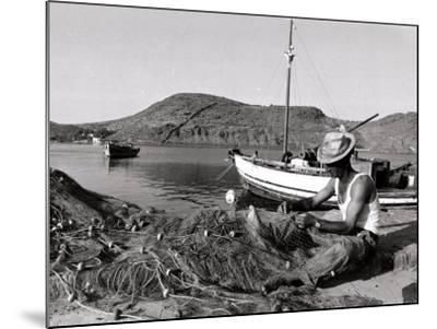 Fisherman Tends to His Nets in Greece--Mounted Photographic Print