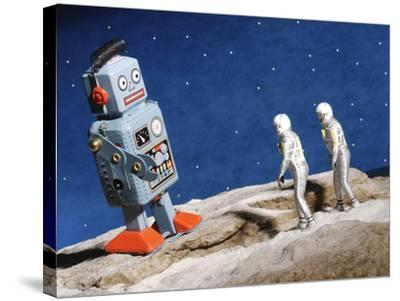 Astronaut Figurines Standing Beside Gray Toy Rocket--Stretched Canvas Print
