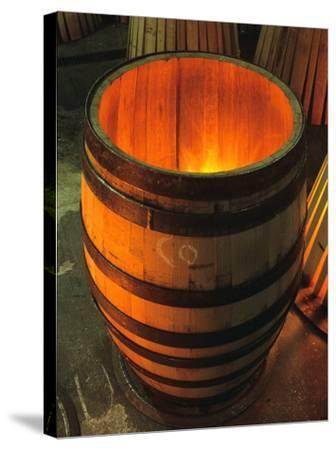 Toasting a New Oak Wine Barrel at the Demptos Cooperage, Napa Valley, California, USA-John Alves-Stretched Canvas Print