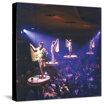 Girls from the Famed Paris Lido Show Performing on Raised Platforms at Stardust Hotel and Casino-Ralph Crane-Stretched Canvas Print