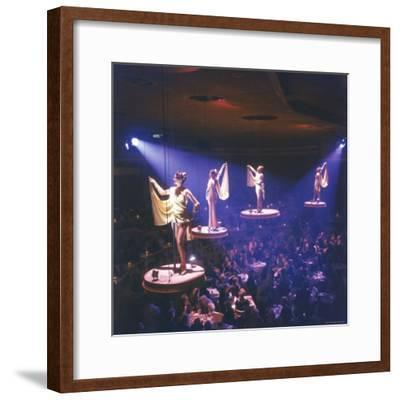 Girls from the Famed Paris Lido Show Performing on Raised Platforms at Stardust Hotel and Casino-Ralph Crane-Framed Photographic Print