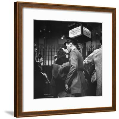 Couple in Penn Station Sharing Farewell Kiss Before He Ships Off to War During WWII-Alfred Eisenstaedt-Framed Photographic Print