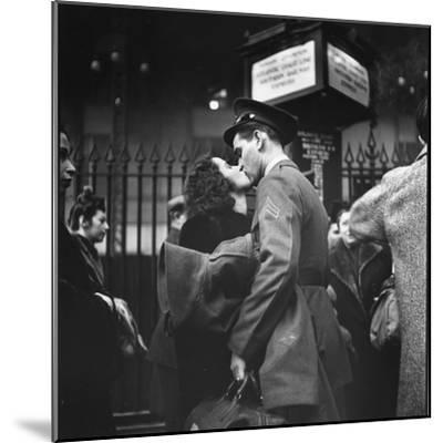 Couple in Penn Station Sharing Farewell Kiss Before He Ships Off to War During WWII-Alfred Eisenstaedt-Mounted Photographic Print