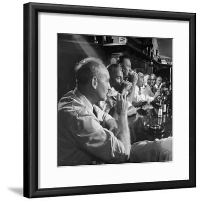 Men Gathered Around For Their Weekly Meeting Indulging in Glasses of Beer-Frank Scherschel-Framed Photographic Print