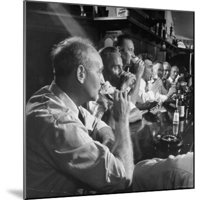Men Gathered Around For Their Weekly Meeting Indulging in Glasses of Beer-Frank Scherschel-Mounted Photographic Print