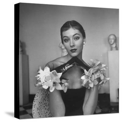 Model Wearing a Flowery Glove While Peering Into the Distance-Nina Leen-Stretched Canvas Print