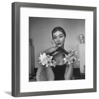 Model Wearing a Flowery Glove While Peering Into the Distance-Nina Leen-Framed Photographic Print