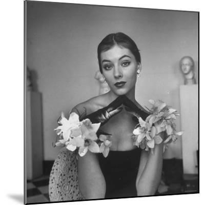 Model Wearing a Flowery Glove While Peering Into the Distance-Nina Leen-Mounted Photographic Print