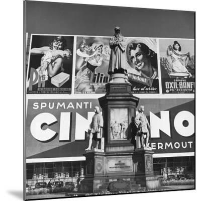Statue of Leonardo Da Vinci on Top of Monument in Front of Giant Advertising Billboard-Alfred Eisenstaedt-Mounted Photographic Print