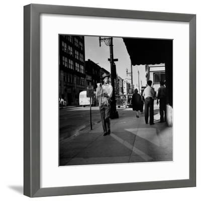Street Scene with Village Atmosphere, Man Carrying Baby-Walker Evans-Framed Photographic Print