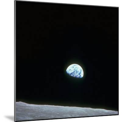 Earth Rising over Curvature of the Moon as Seen from Apollo 8--Mounted Photographic Print