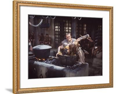 "Kirk Douglas Dunking Enemy's Head in Giant Cook Pot in Scene From Stanley Kubrick's ""Spartacus""-J^ R^ Eyerman-Framed Premium Photographic Print"