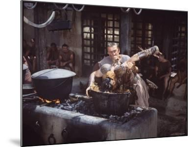 """Kirk Douglas Dunking Enemy's Head in Giant Cook Pot in Scene From Stanley Kubrick's """"Spartacus""""-J^ R^ Eyerman-Mounted Premium Photographic Print"""