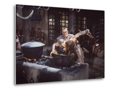 "Kirk Douglas Dunking Enemy's Head in Giant Cook Pot in Scene From Stanley Kubrick's ""Spartacus""-J^ R^ Eyerman-Metal Print"
