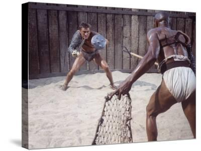 """Actor Kirk Douglas Faces Actor Woody Strode in Scene From Stanley Kubrick's Film """"Spartacus""""-J^ R^ Eyerman-Stretched Canvas Print"""
