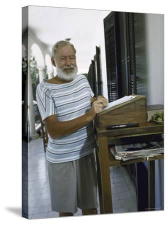 Ernest Hemingway at the Standing Desk on the Balcony of Bill Davis's Home Near Malaga-Loomis Dean-Stretched Canvas Print