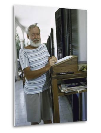 Ernest Hemingway at the Standing Desk on the Balcony of Bill Davis's Home Near Malaga-Loomis Dean-Metal Print