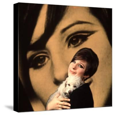 Singer and Actress Barbra Streisand Holding Small Dog in Her Arms-Bill Eppridge-Stretched Canvas Print