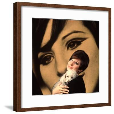 Singer and Actress Barbra Streisand Holding Small Dog in Her Arms-Bill Eppridge-Framed Premium Photographic Print