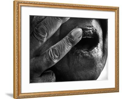 Jazz Trumpeter Louis Armstrong Massaging Lips with Balm to Keep Them Strong for Playing His Trumpet-John Loengard-Framed Premium Photographic Print
