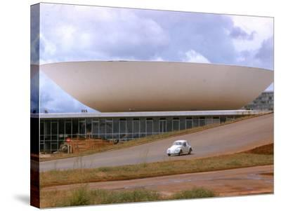 Three Powers Square Building Built by Oscar Niemeyer as Volkwagan drives by-Dmitri Kessel-Stretched Canvas Print