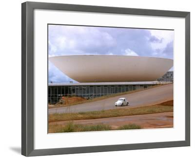 Three Powers Square Building Built by Oscar Niemeyer as Volkwagan drives by-Dmitri Kessel-Framed Photographic Print