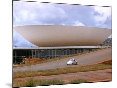Three Powers Square Building Built by Oscar Niemeyer as Volkwagan drives by-Dmitri Kessel-Mounted Photographic Print