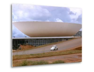 Three Powers Square Building Built by Oscar Niemeyer as Volkwagan drives by-Dmitri Kessel-Metal Print