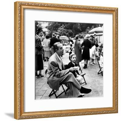 Vincente Minnelli with coffee sitting in chair with Daughter Liza at Outdoor Children's Party Being-J^ R^ Eyerman-Framed Premium Photographic Print