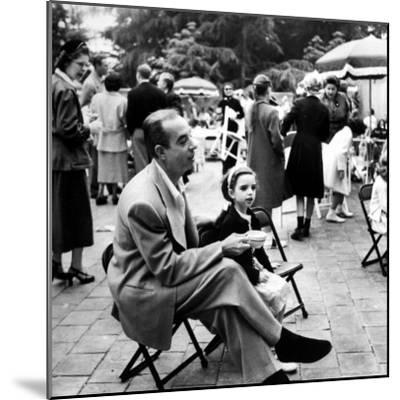 Vincente Minnelli with coffee sitting in chair with Daughter Liza at Outdoor Children's Party Being-J^ R^ Eyerman-Mounted Premium Photographic Print