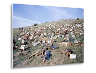 """Extras Playing Dead People Hold Numbered Cards Between Takes During Filming of """"Spartacus""""-J^ R^ Eyerman-Metal Print"""