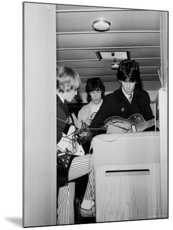 Members of the Rolling Stones Checking Their Instruments Before a Concert at Forest Hills Stadium-Walter Daran-Mounted Premium Photographic Print