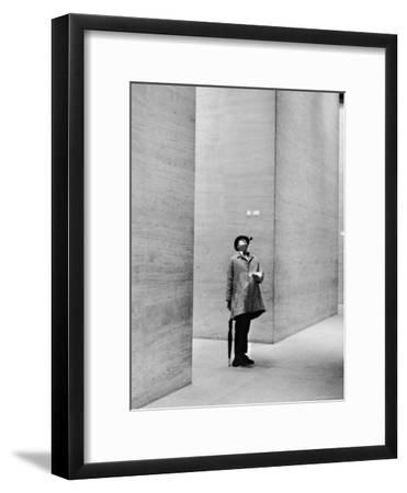 French Actor Jacques Tati Looking at the High Ceiling of an Office Lobby-Yale Joel-Framed Premium Photographic Print