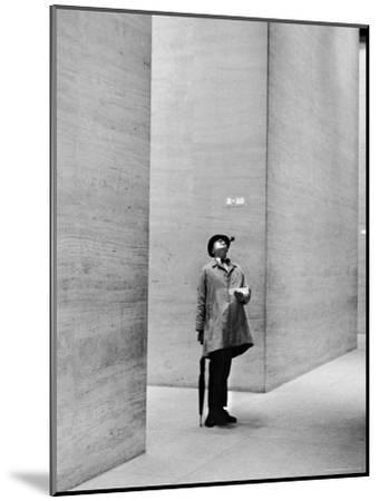 French Actor Jacques Tati Looking at the High Ceiling of an Office Lobby-Yale Joel-Mounted Premium Photographic Print