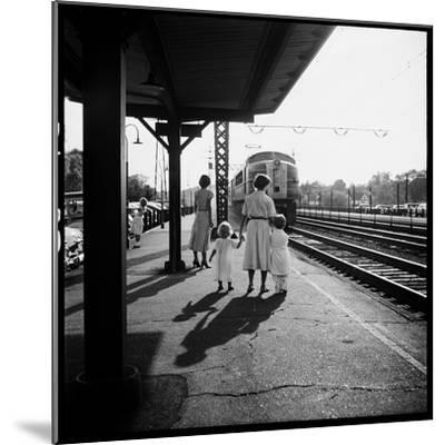 Insurance Broker Charles Hoffman's Wife Bringing Children to Train Station to Wait for His Arrival-Nina Leen-Mounted Photographic Print