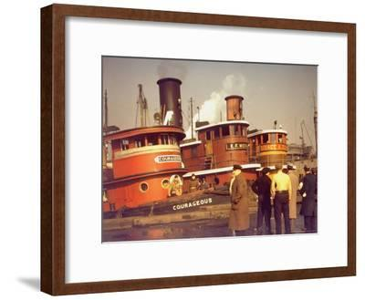 """Men at pier looking at 3 Tugboats, One Named """"Courageous"""" with Crewmen on Deck-Andreas Feininger-Framed Photographic Print"""