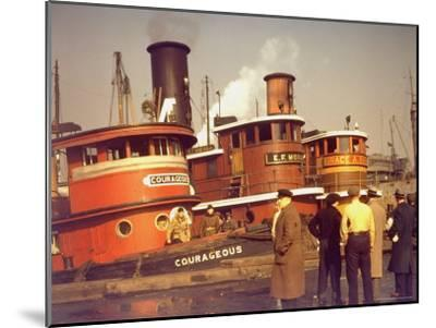"""Men at pier looking at 3 Tugboats, One Named """"Courageous"""" with Crewmen on Deck-Andreas Feininger-Mounted Photographic Print"""