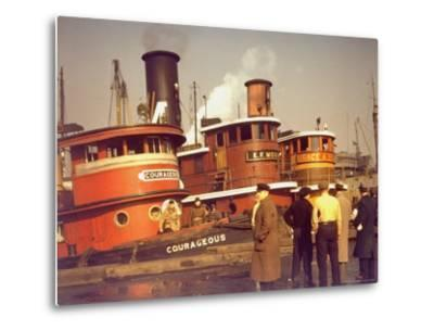 """Men at pier looking at 3 Tugboats, One Named """"Courageous"""" with Crewmen on Deck-Andreas Feininger-Metal Print"""