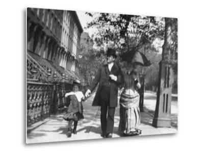 Incredibly Well Dressed Man, Woman and Child Walking by Perfect Brownstone Apartment Buildings-George B. Brainerd-Metal Print