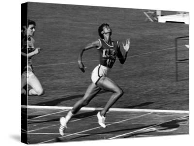 Wilma Rudolph, Across the Finish Line to Win One of Her 3 Gold Medals at the 1960 Summer Olympics-Mark Kauffman-Stretched Canvas Print