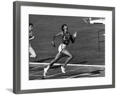 Wilma Rudolph, Across the Finish Line to Win One of Her 3 Gold Medals at the 1960 Summer Olympics-Mark Kauffman-Framed Premium Photographic Print