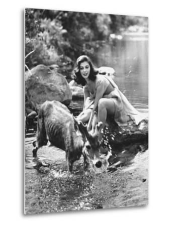 Actress Pier Angeli, Clad in Strapless Chiffon Party Dress Sitting on a Rock in a Pond-Allan Grant-Metal Print