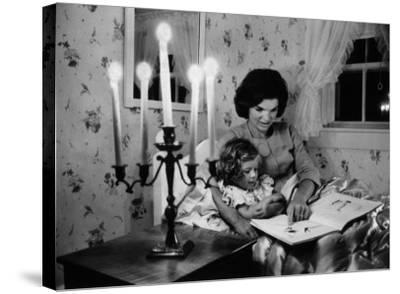 Wife of Senator Jackie Kennedy Reading Book to Her Daughter Caroline In Family's summer home-Alfred Eisenstaedt-Stretched Canvas Print