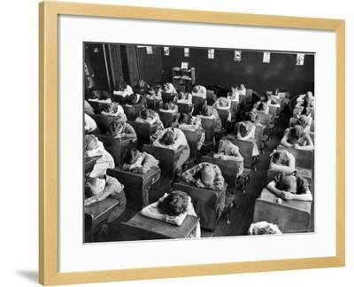 Elementary School Children with Heads Down on Desk During Rest Period in Classroom-Alfred Eisenstaedt-Framed Photographic Print
