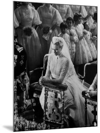Actress Grace Kelly in Gorgeous Wedding Gown Praying During Her Wedding to Prince Rainier-Thomas D^ Mcavoy-Mounted Premium Photographic Print